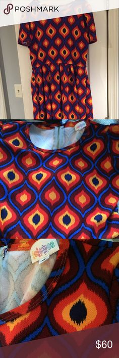 BNWOT XL Amelia Dress LuLaRoe BNWOT XL Amelia Dress - this is a BEAUTIFUL Amelia in an almost Aztec Print. A closeup of the print is in the pictures. The colors in the dress are dark blue, royal blue, yellow, orange, and maroon. LuLaRoe Dresses