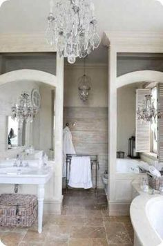 Everything I love… grey walls, old wood boards, white pedestal sink and the chandelier!