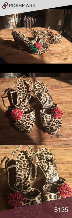 """Dolce and Gabbana leopard Wedges. Make a statement in these cute wedges with a red flower with little stone and green leaves  on the front strap. Adjustable open back 4"""" wedge. These wedges are very comfortable and supportive. Dolce & Gabbana Shoes Wedges"""