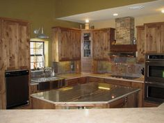 I like the kitchen faucet and the pot filler above the stove, nice island too