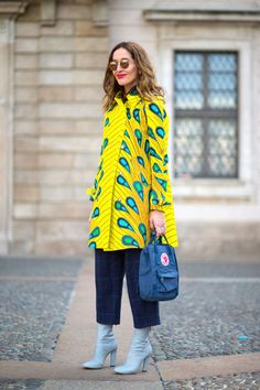 Fashion Week Street Street. Yellow peacock at Milan Fashion Week Fall 2015 #MFW