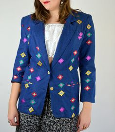 Awesome 1980s light denim cotton blazer. Fully embroidered in a colorful southwestern pattern. Oversized fit with shoulder pads. Fully Lined. Made in Canada.  SIZE: Medium - Large LABEL: -- BRAND: Amen Wardy Excellent Vintage Condition  Measurements: Shoulders: 18 Chest: 42 Waist: 40 Sleeve: 16.5 Length: 29  Alexias Measurements; Bust: 38 Waist: 33 Hips: 44 Height 6 1  T2016WARDY  *Any overpayment exceeding $4 USD will be refunded back to your account.  *All items are measured in US inches…