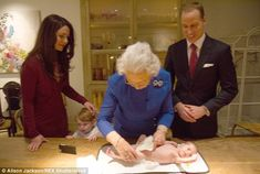 Her Majesty rolled up her sleeves and showed the Duke and Duchess exactly how to change a nappy