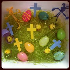 Hudson's 2012 Easter Sensory Tub- Easter grass, baby chicks, plastic eggs, foam crosses of different sizes and bendable Easter bunnies
