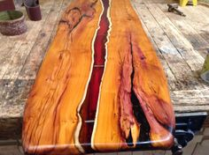 Live edge Yew. Coffee table top with Amber resin flowing through the wood. Green Tree Furniture,