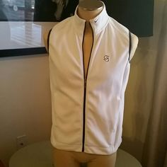 Nike Fit Therma Women's Golf Vest Adorable women's white golf vest with navy trim! 100% polyester, size medium (fits size 8-10). No noticeable signs of wear. Perfect for spring! Nike Jackets & Coats Vests