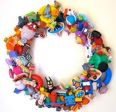 Totally love this recycled plastic toy wreath DIY - really easy and fun, and a great way to get all of your plastic toys in one place too! Recycled Toys, Recycled Crafts, Fun Crafts For Kids, Arts And Crafts, Church Nursery, Toy Rooms, Old Toys, How To Make Wreaths, Craft Projects