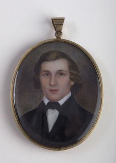"""Oval Portrait Miniature of a Gentleman in Black Coat & Cravat. American School, Circa 1850 - Watercolor on ivory 2 1/2 x 2 inches. The reverse of the case with aperture displaying a plait of hair & engraved with initials """"TLC"""""""