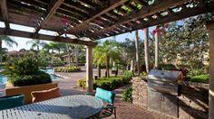 Outdoor kitchen by Brandel Masonry under a pergola in Lakes at Pembroke development in Pembroke Pines, Florida.