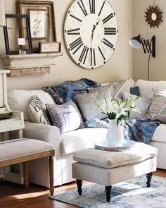 You have to see this #farmhouse living room decor idea with attention-grabbing wall clock and comfortable sofa. Love it! #RusticDecor #HomeDecorIdeas