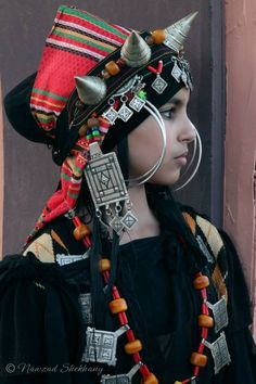 Africa | Amazigh girl in traditional costume during the Kawafil Festival. Morocco, 2013 | ©Nawzad Skekhany.