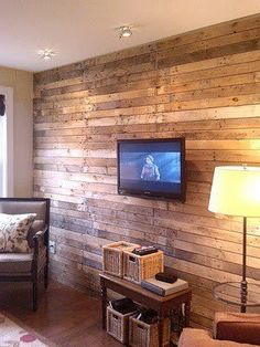 From pallets into paneled wall.. This is what I want for the wall behind jaxs bed, with bright art work. Then on opposing side have blue stripes on wall with rustic wood and white deer head.