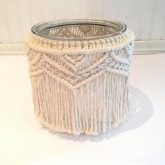 Please Note: This item is made to order! Please allow 2-3 + shipping for delivery. 7.75 tall x 7.5 wide with 5.75 opening glass jar. Covered with 3mm unbleached cotton macrame string. Add some sand and a candle & it becomes the perfect bohemian candle holder. Fill it with flowers for a unique vase. Group several together for a table centerpiece. Great for weddings, home & holiday decor. Every item is handmade by me. No two are exactly alike. I like to think of them as perfectly imp...