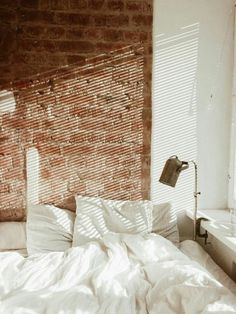 clean white paired with exposed brick // cozy perfection