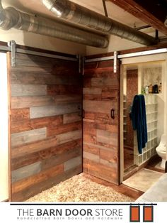 Look  at these #barndoors!! We love the industrial look and the barn doors are a perfect fit!  Mixed Plank Doors  Stained Provincial  Mushroom Gray  Installed in #PhoenixAZ Hung Over Bathroom/Bedroom Entryway  #loftliving #AZbarndoors #barndoordecor  TheBarnDoorStore.com