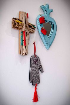 MEXICAN TRIPTYCH - $59 This gorgeous Mexican Inspired Collection, comes as a set of three pieces. Which consists of an aqua heart mirror, a driftwood cross and a pressed tin hand with red tassel. Pressed Tin, Heart Mirror, Triptych, Affordable Art, Art For Kids, Folk Art, Garland, Objects, Mexican