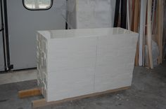 Chest of drawers ,white laquered with bas -relief .