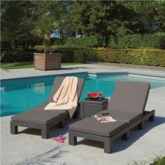 Relax in the comfort of your own backyard with these grey weather resistant sun loungers.