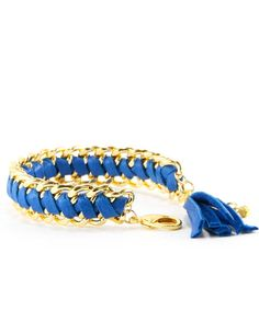 Gold link bracelet with woven blue leather.