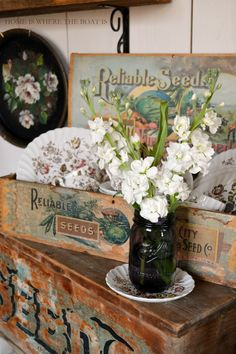 White Stock in an anniversary purple Heritage Ball Jars and beautiful antique seed box