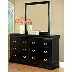 @Overstock - This traditional, six-drawer Marikina dresser by Enitial Lab is topped with a beautifully beveled mirror, both finished in stunning black. Silver-finished round handles pull the drawers of this solid wood dresser out on smooth, metal glides.  http://www.overstock.com/Home-Garden/Enitial-Lab-Marikina-Black-Dresser-with-Mirror/6674611/product.html?CID=214117 $619.99
