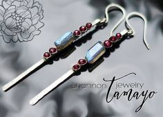 Beautiful blue flash labradorite nuggets are perfectly paired with juicy ruby-red garnet rondelles - I absolutely love this combination of gemstones!  Available at: http://ift.tt/2f8KWyV  I used sterling silver to hand-forge the earrings and very very fine argentium silver to wire wrap the gemstones in place. The earrings were oxidized and polished to add depth and dimension. The result is gorgeous ear candy perfect for dressing up or down worn solo or with the rest of the matching set.  The…