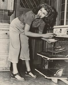 Rita Hayworth at home in 1942...This is how we fixed toast when I was a kid. No fancy pop up toaster for us.
