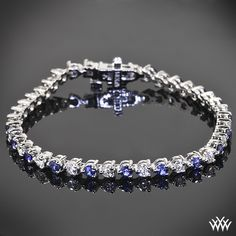 This beautiful tennis bracelet is set in 18k white gold and holds 1.80ctw of alternating A CUT ABOVE® Hearts and Arrows Diamond Melee and blue sapphires.
