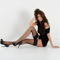 Very sexy look !! Great legs in black stockings LBD & heels!!