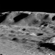 The largest mountains on the Moon rival those of the Earth. Here Zeeman Mons (informal name) rises more than 7,570 m (24,500 ft, 73.39°S, 213.31°E) above the floor of Zeeman Crater, and the flank of Zeeman Y is just visible on the right side of the image. View looking to the west from an altitude of 33 km (21 miles); image M1224507290LR. (Credit: NASA/GSFC/Arizona State University)