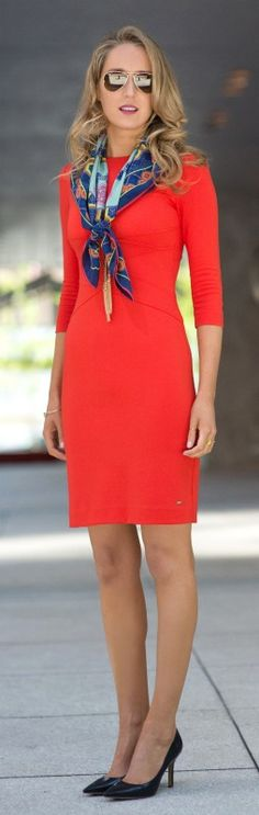 coral orange criss cross front sheath dress + versace silk square multi colored scarf + gold lariat necklace + classic navy pumps
