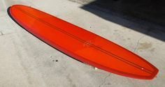 """RARE THOMAS BEXON SURFBOARD-HARRISON ROACH CONCEPT MODEL 9'5""""x23""""x3"""" Single fin w/box Red orange tint with sanded glass coat."""