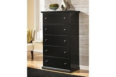 Tall wooden black chest with five drawers and pewter colored knobs to add to your bedroom