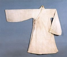 The Dopo is said to have originated in the time of King Seonjo (ruled 1567-1608).  This bleached cotton dopo, belonging to General Park was found in his tomb in Cheongwon, circa 1590s.  Important Folklore Material 117-16.