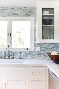 Glass mosaic backsplash: Agate in Lucca Pearl by Stone & Pewter Accents. Design by Charmean Neithart Interiors. Photos by Erika Bierman www.erikabiermanphotography.com