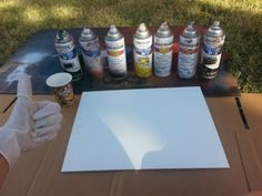 5. Make sure all the colors and supplies are lined up close by, it dries quick! I don't have a photo for this but spray your favorite colors on one spot of the canvas and dab crumpled newspaper on it to give  texture, place the cup on top when you are happy with how it looks.
