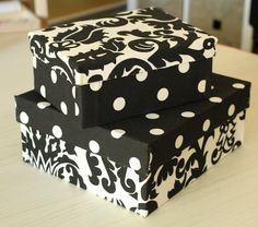 Shoeboxes covered with fabric using hot glue. So cute! I wonder if this could work?