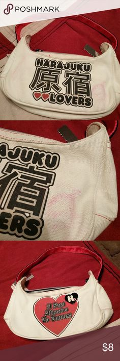 Harajuku lovers bag Cute mini bag has pink stain on front but can easily be cleaned. Made by Gwen Stefani Harajuku Lovers Bags Mini Bags
