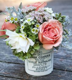 Pretty informal flower arrangement in a vintage marmalade jar.