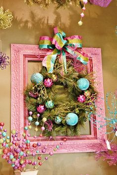 Colorful wreath set within a picture frame.... so easy to make for Christmas