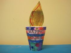 "Diwali diya craft - paper ""flame"" in plant pot"