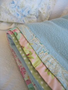 Replace tattered edges on old blankets with pretty new/vintage fabric.