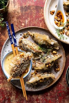 Crispy Sesame Ginger Potstickers with Chive Chili Sauce Recipe - crispy on the bottom and served with a sweet and spicy chive chili garlic sauce! So delish!