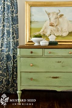 Luckett's Green milk paint by Miss Mustard Seed. Love the dresser, I'll leave the cow painting lol