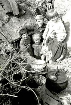children cooking a meal in dirty pots with nearly no food during WW II
