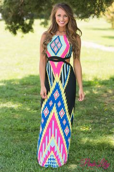 This fitted aztec maxi is perfect for your next girls night out or night at the club! There's cutouts along the side, back, and middle of the dress for a trendy look, while the bold neon pink, yellow, teal, blue, and black pattern will stand out in a crowd!