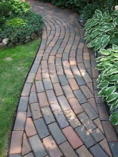 Curving brick path within a curved path. Using Pacific Interlock's Holland pavers in (red/tan/charcoal) you can make this in your garden. Paver Pathway, Outdoor Walkway, Paver Sand, Paver Edging, Paver Stones, Concrete Pavers, Landscape Design, Garden Design, Landscape Bricks