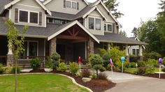 Choice Construction, Remodel, Custom Homes, Gig Harbor, House Exterior, Concrete Walkway, Landscaping, Wood Beams, Stone Columns, Front Patio