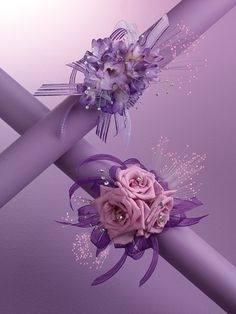 A couple lavender/purple wrist corsages using the popular Magic-Lights (fiber optic lights) Not available any longer ( that I'm aware of) but they were sure fun while we had them :)