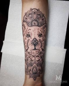 Lioness mandala style tattoo. Forearm tattoo with linework and dot work Mandala. Animal tattoo - tattoo ideas for girls! By Gav Guest at Marked One Tattoo.